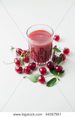 Sour cherry juice and fresh organic sour cherry