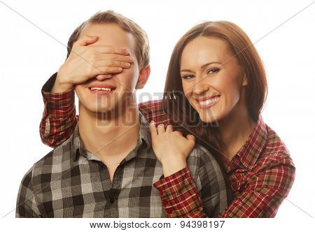Couple in love. Young woman closing his boyfriend eyes.