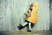 image of dragon  - Little dreamer boy playing with a cardboard dragon - JPG
