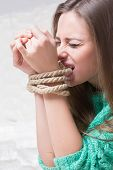 foto of sadism  - girl with his hands tied - JPG