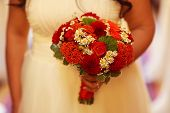 picture of wedding feast  - Capture of Bride holding red wedding bouquet - JPG