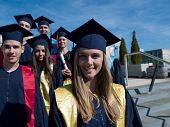 foto of graduation  - young graduates students group  standing in front of university building on graduation day - JPG