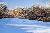 stock photo of cottonwood  - frozen Cache la Poudre River in Fort Collins - JPG