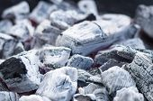 picture of charcoal  - Smouldering and burning charcoal closeup blurred background - JPG