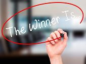 picture of winner  - Man Hand writing The Winner Is - JPG