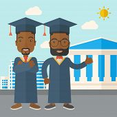 stock photo of toga  - Happy two black young men wearing a toga and graduation cap standing under the sun - JPG