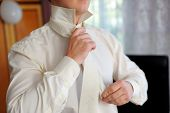 picture of tied  - Groom to tie a tie to the shirt - JPG