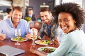 picture of lunch  - Group of friends at lunch in a restaurant - JPG