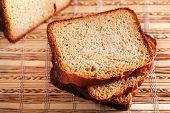 picture of home-made bread  - Slices of home made bread on wooden background - JPG