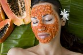 picture of facials  - Beautiful caucasian woman having fresh papaya natural facial mask apply skin care and wellness  - JPG
