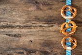 stock photo of pretzels  - Bavarian pretzels on old wooden background for Oktoberfest - JPG