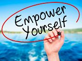 stock photo of empower  - Man Hand writing Empower Yourself with black marker on visual screen - JPG