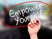 picture of empower  - Man Hand writing Empower Yourself with black marker on visual screen - JPG