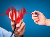 pic of heart surgery  - Closeup portrait doctor hand listening to heart beat in heart shape with stethoscope - JPG