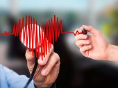 picture of heart surgery  - Closeup portrait doctor hand listening to heart beat in heart shape with stethoscope - JPG