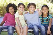 pic of 11 year old  - Group Of Children Sitting On Edge Of Trampoline Together - JPG