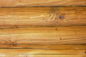 stock photo of log cabin  - A log cabin wall built from logs as a background - JPG