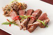 stock photo of flank steak  - steak with noodles - JPG