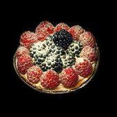 image of blackberries  - Raspberry and blackberry tartlet isolated on black background - JPG