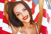 pic of independent woman  - Sexy woman portrait with usa flag in sunset outdoor 4th july - JPG