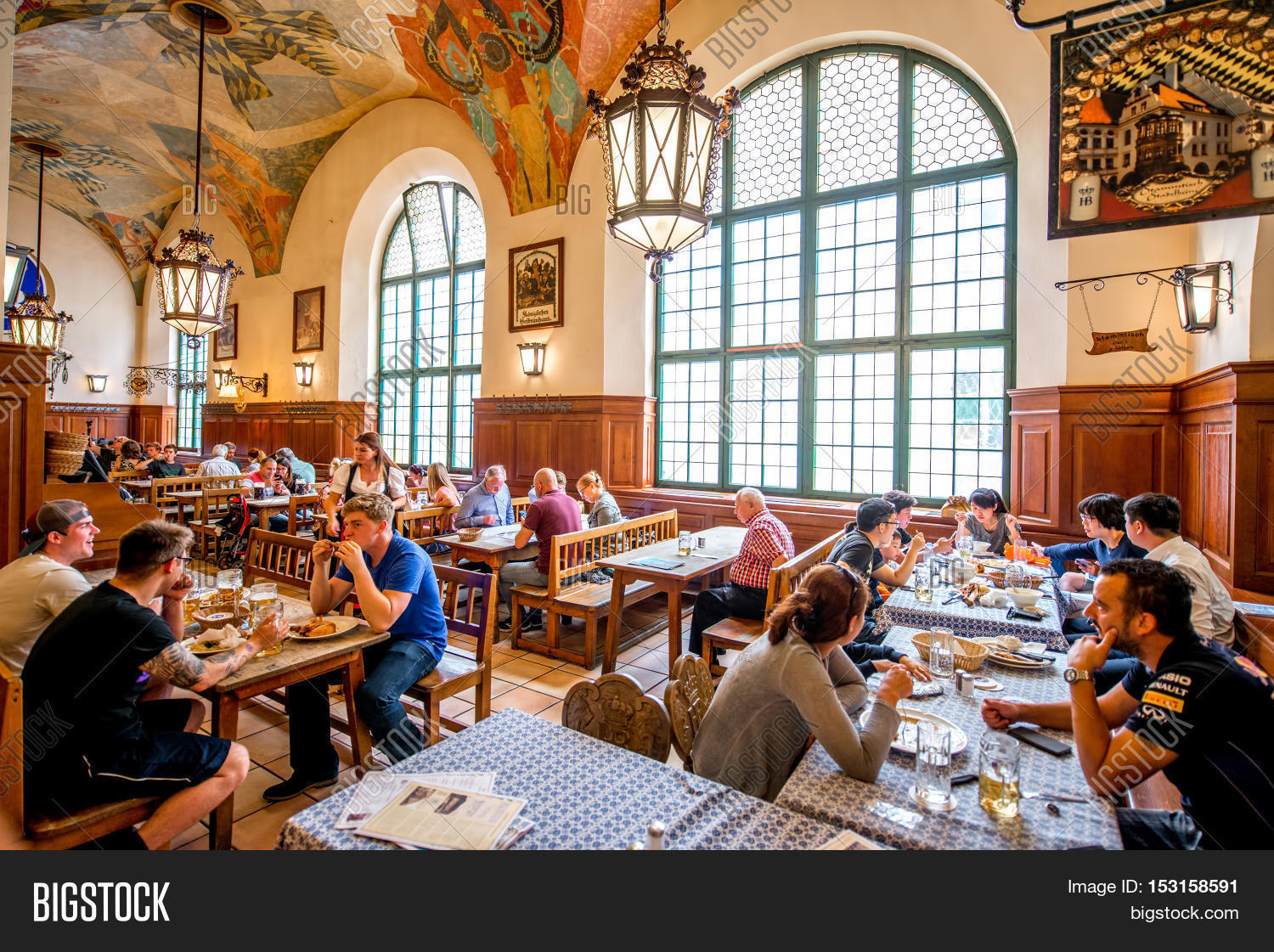 Crowded restaurant table - Munich Germany July 03 2016 Crowded Interior Of Famous Hofbrauhaus Pub In
