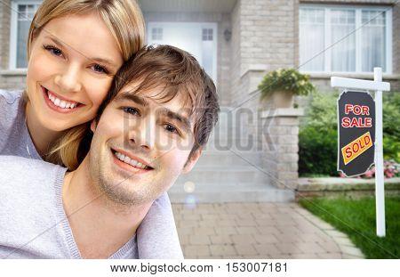 Happy couple near new house.
