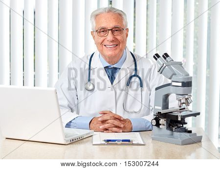 Elderly doctor man in hospital.