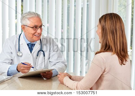 Elderly doctor man with patient woman.