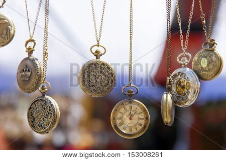 Many vintage pretty watches hanging. Antique look.