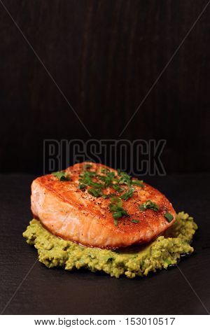Grilled salmon fillet with avocado mash and green leek