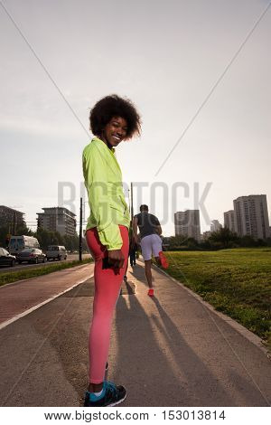 portrait of a young African American girl to run beautiful summer morning on city streets