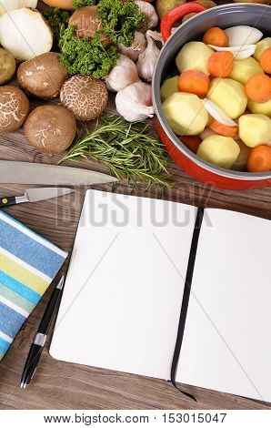 Cook Book With Vegetables And Casserole Dish