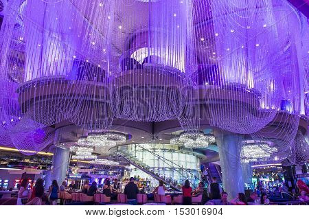 LAS VEGAS - OCT 05 : The Chandelier Bar at the Cosmopolitan Hotel & Casino in Las Vegas on October 05 2016. This tri-level chandelier encases the hotels 3 bars in illuminated crystals.
