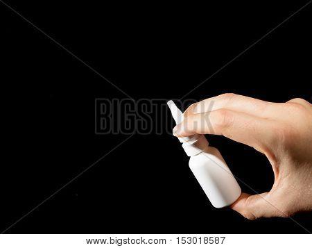 White Bottle Of Nasal Spray On Black