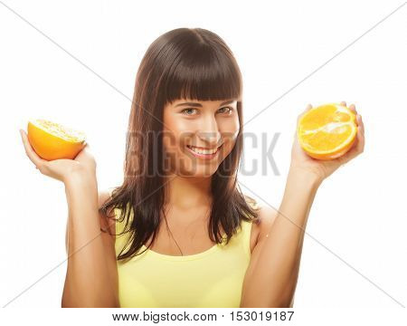 People, health and diet concept: woman with oranges in her hands studio portrait isolated on white background