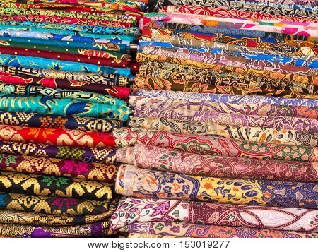 Colorful sarongs on sale in the market at Ubud in Bali Indonesia.