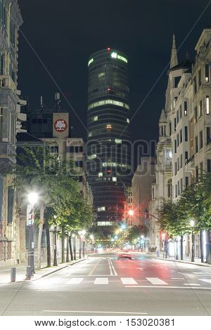 BILBAO, SPAIN - OCTOBER 24, 2016: Exterior view of the south east side of the Iberdrola tower at night. Headquarters of the electric company Iberdrola.