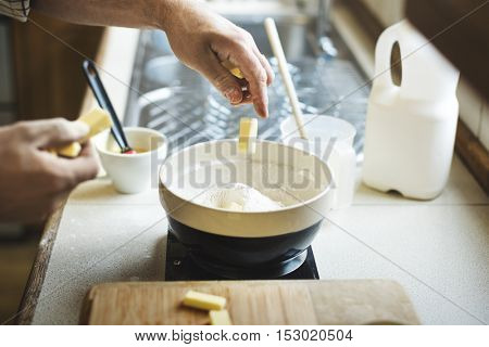 Man Mixing Butter Milk Pastry Bakery Concept