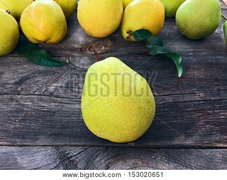 Ripe pear on a gray background pears on old wooden background
