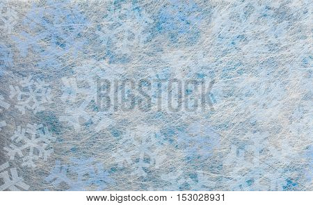 Several dark and light blue snowflakes, cold winter background