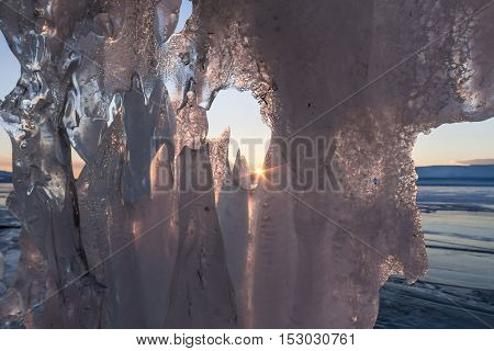View Of The Sunrise From The Ice Grotto In The Pattern, On The Island Of Olkhon, Lake Baikal
