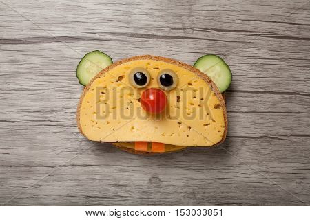 Hamster made of bread and cheese on desk