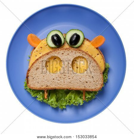 Hippo made of bread and vegetables on plate