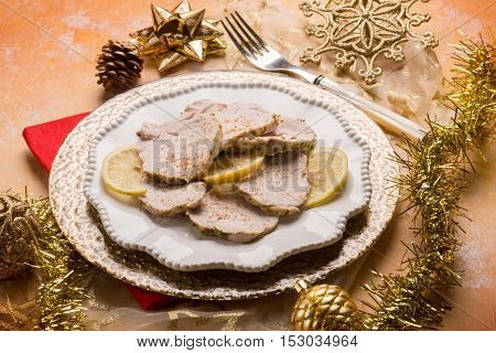 roast meat over gold christmas table