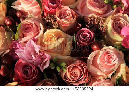 Pastel roses in different shades of pink in a bridal arrangement