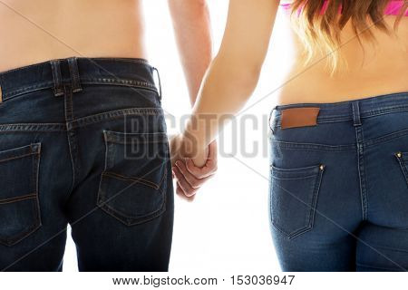 Man and woman holding hands together.