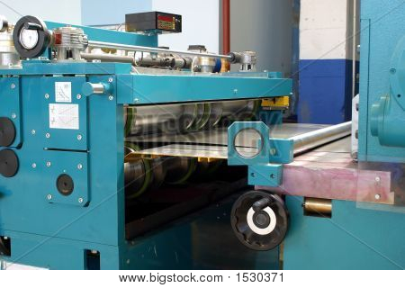 Machine For Cutting And Slitting Sheet To Length