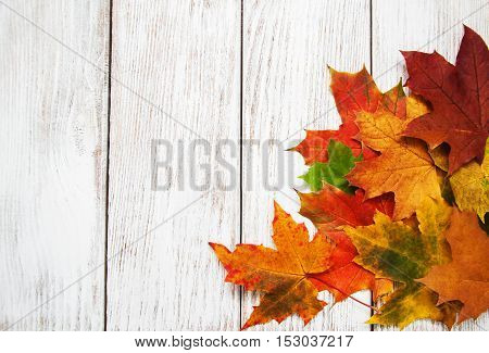 Colorfu autumn leaves on a old wooden background