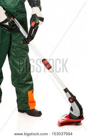 Gardener trimming wearing protective gloves