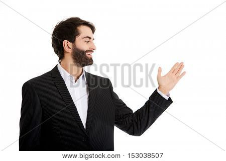 Young businessman presenting something.